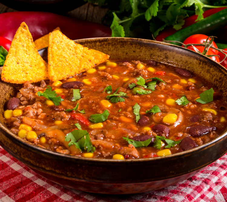 Chili with chips and cilantro