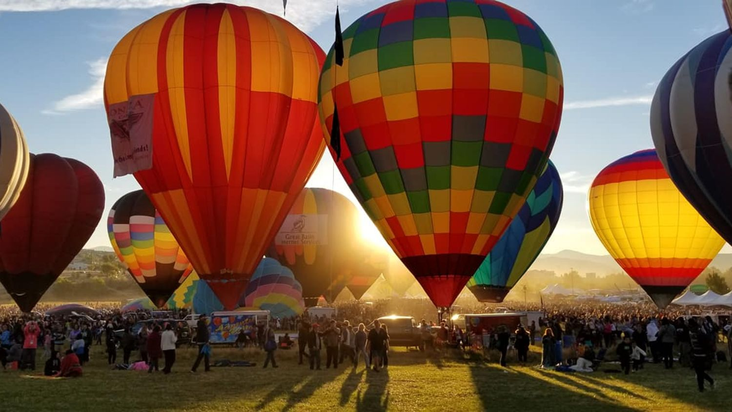 Hot air balloons with crowd watching